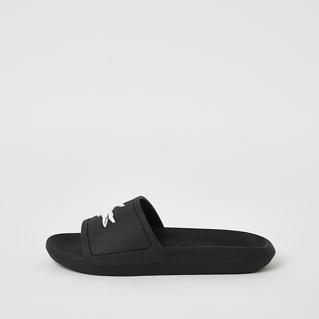 Lacoste black brand embossed sliders