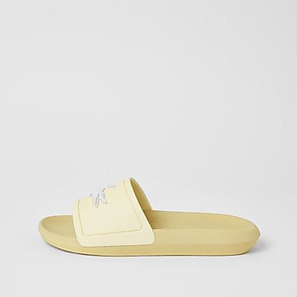 Lacoste yellow brand embossed sliders