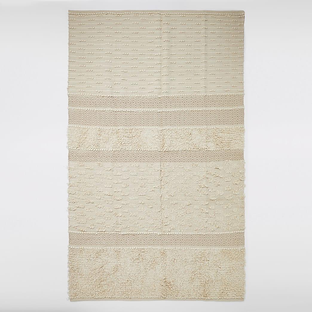 Groot getuft tapijt in crème en goud