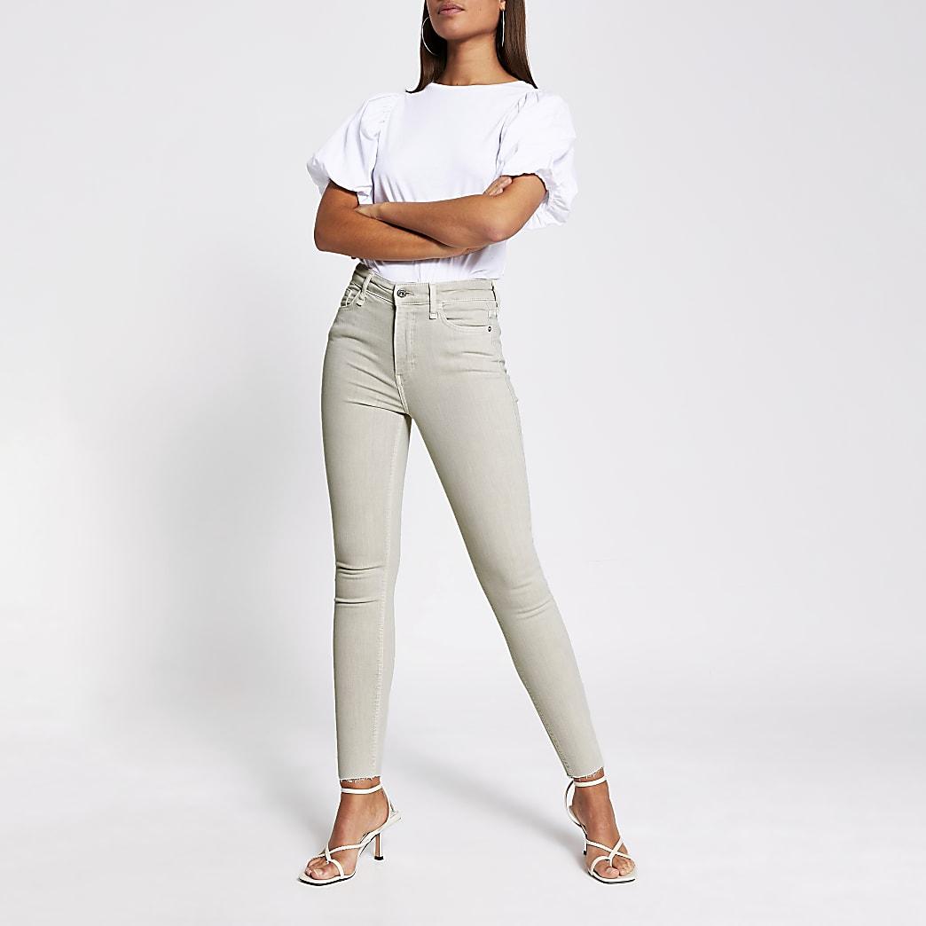 Light beige high rise skinny jeans