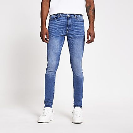 Light blue Ollie spray on skinny jeans