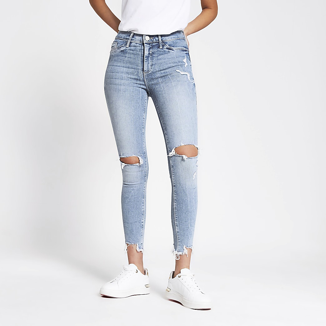 Light blue ripped Molly mid rise jeggings