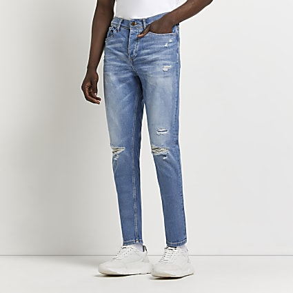 Light blue ripped tapered jeans