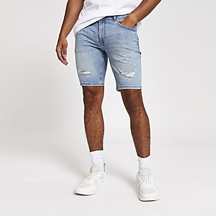 Light blue skinny Sid paint splat shorts