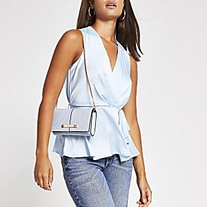 Light blue sleeveless wrap top