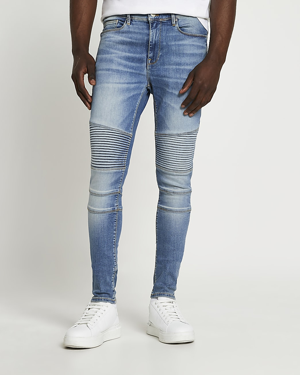 Light blue spray on skinny fit biker jeans