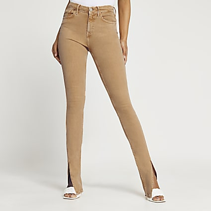 Light brown slim high rise split hem jeans
