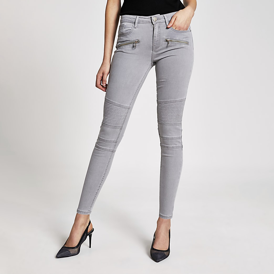 Light grey skinny zip front biker jeans