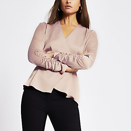 Light pink long sleeve wrap top