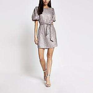 Lichtpaarse mini-jurk met pailletten en strikceintuur