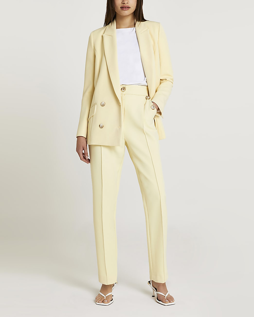 Light yellow tapered trousers
