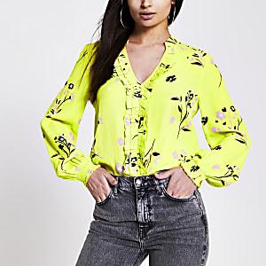 Geelgroene blouse met bloemenprint V-hals en ruches voor