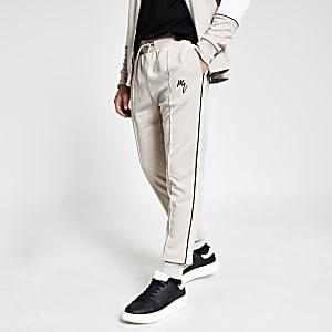 Maison Riviera – Pantalon de jogging slim beige passepoilé