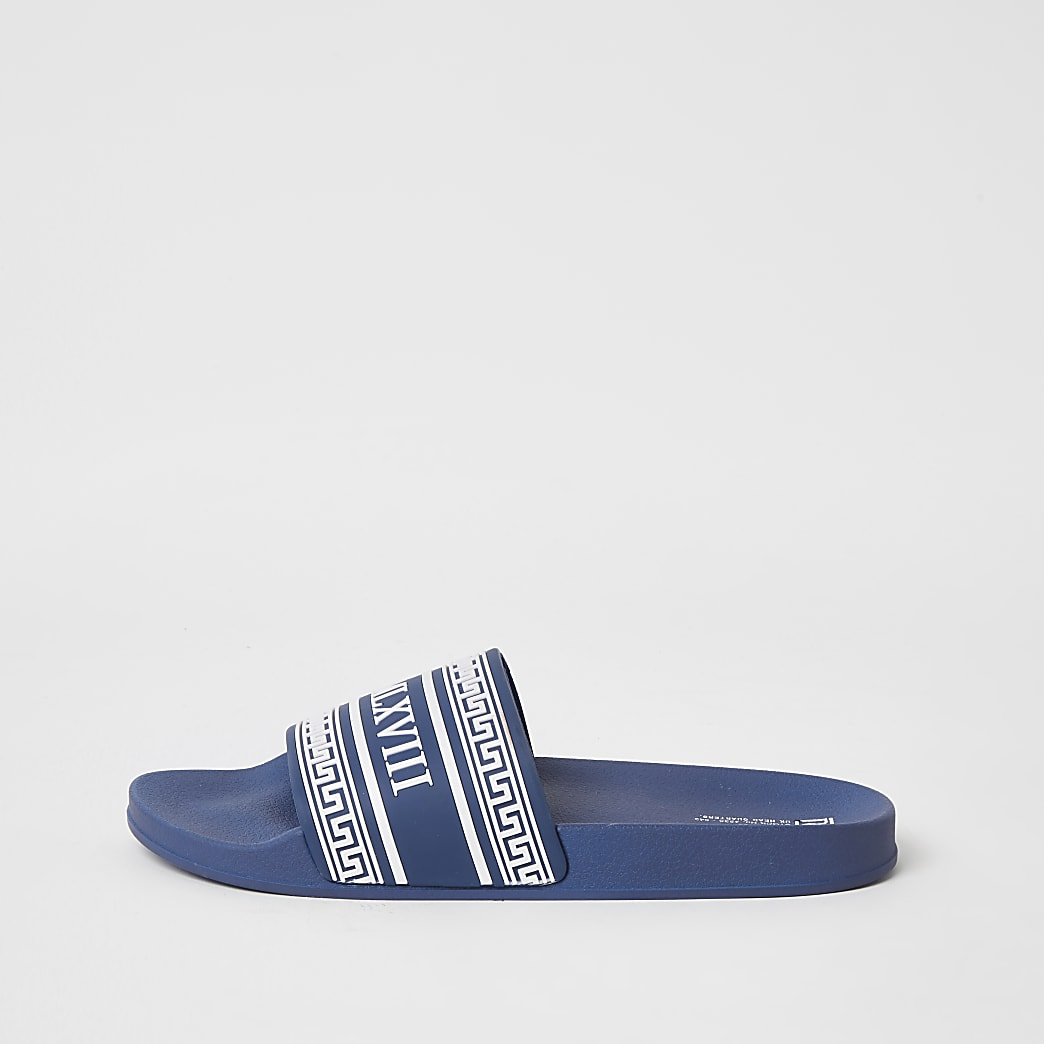 MCMLX blue embossed sliders