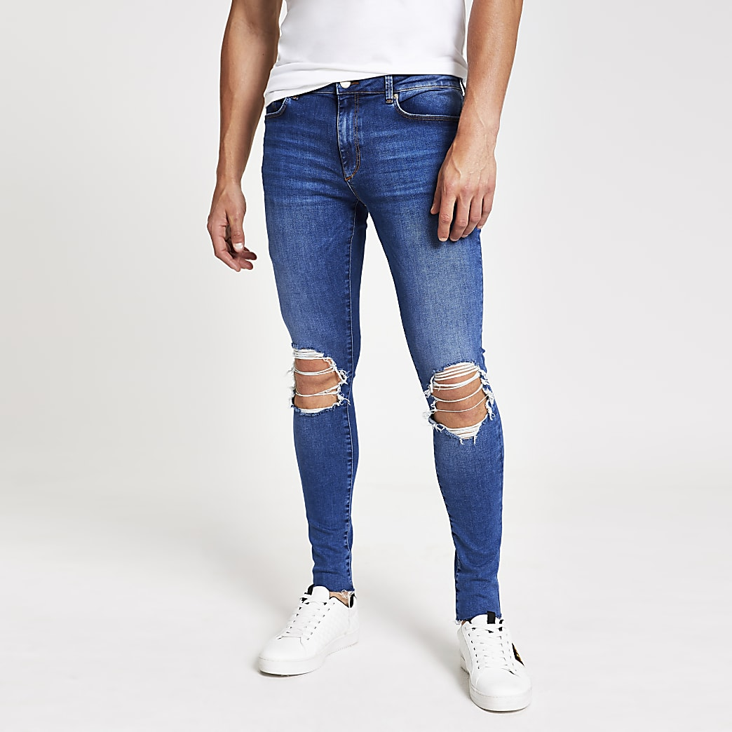 Ollie - Middenblauwe ripped spray-on skinny jeans