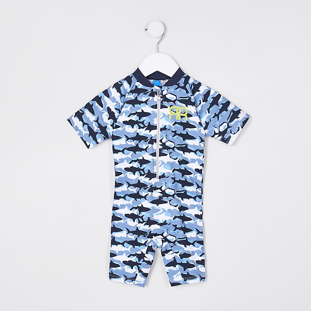 Mini boys blue camo shark all in one swimsuit