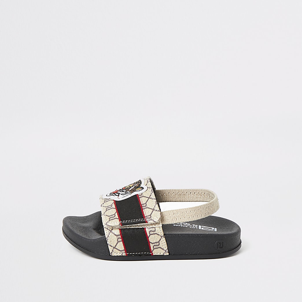 Mini -Bruine slippers met tijgerprint en RI-monogram