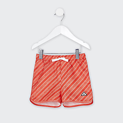 Mini boys red RI monogram swim shorts
