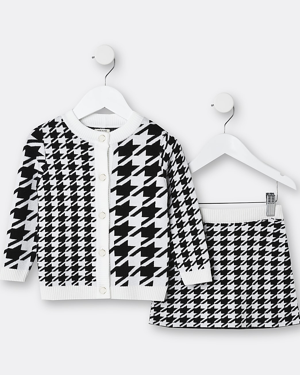 Mini girls black dogtooth cardigan and skirt