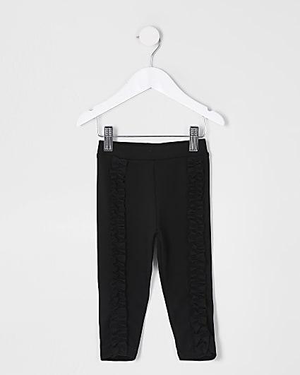 Mini girls black frill front leggings