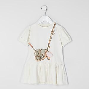 Mini – T-Shirt-Kleid in Creme mit Taschen-Print