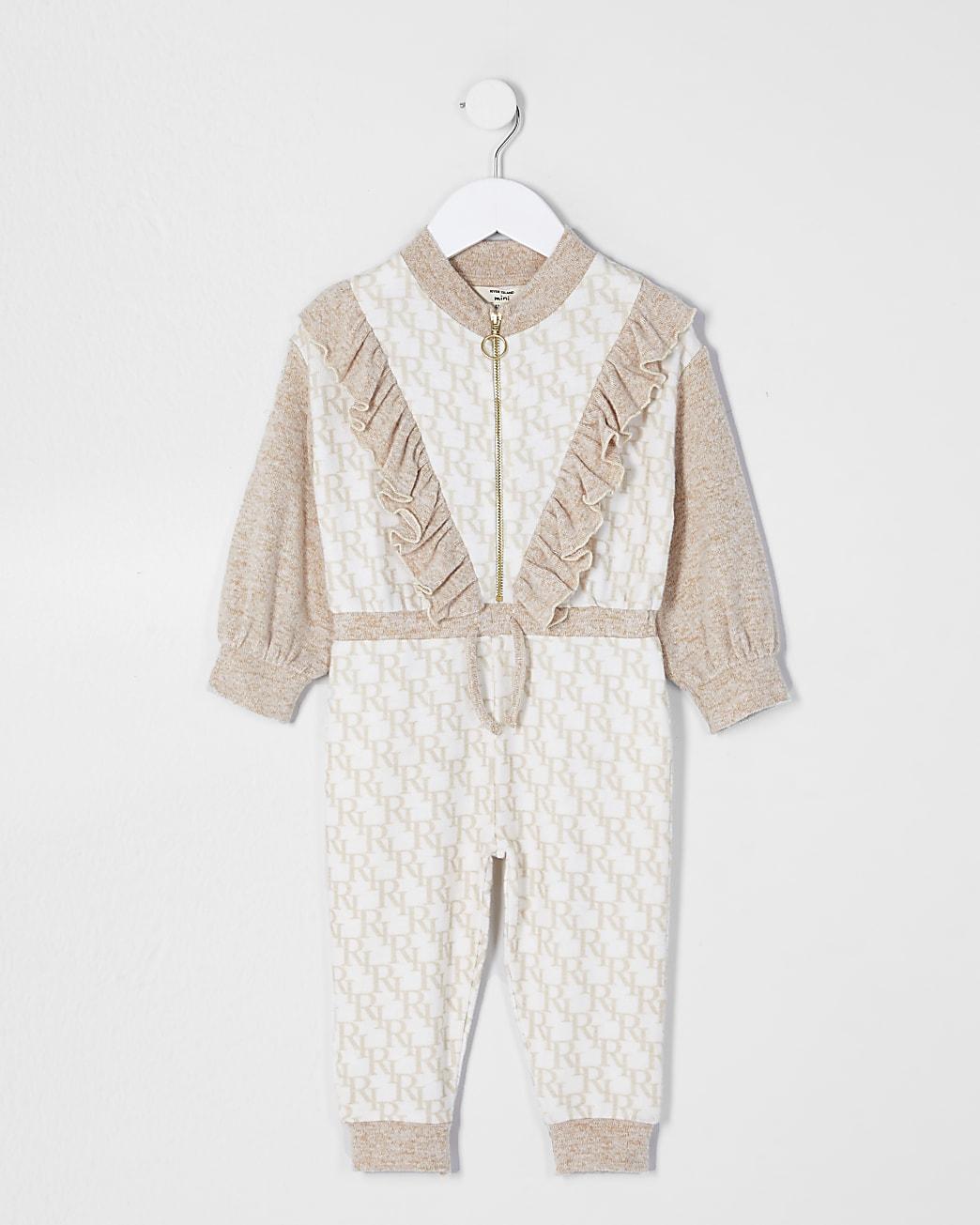 Mini girls cream monogram print jumpsuit
