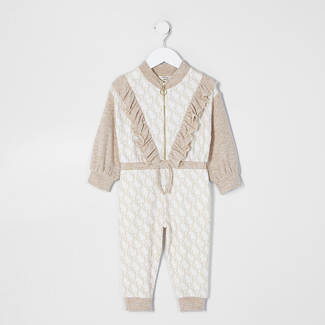Mini girls cream monogram print jumpsuit