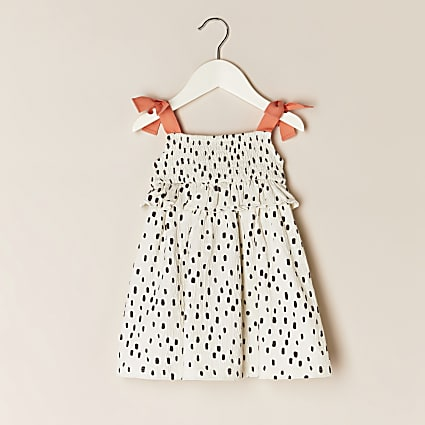 Mini girls cream polka dot dress