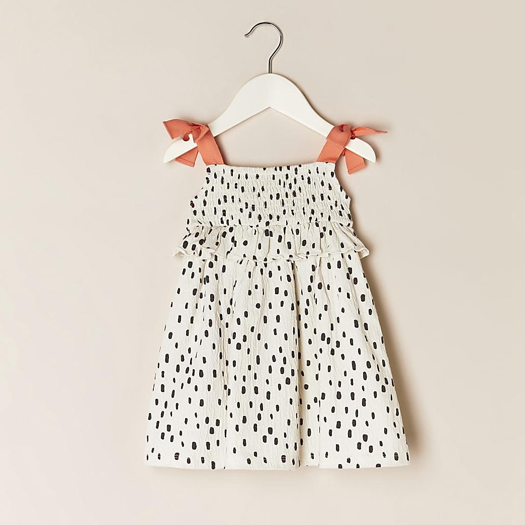 Mini girls cream polka dot dress