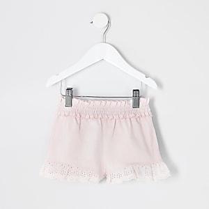 Mini– Gerüschte Shorts in Rosa mit Lochstickerei