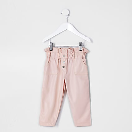 Mini girls pink faux leather trousers