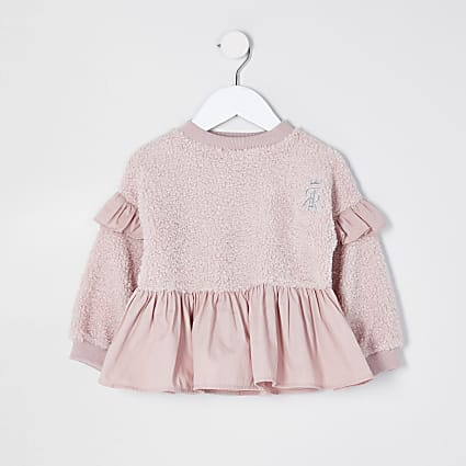 Mini pink borg peplum sweatshirt