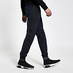 Marineblauwe nylon slim-fit joggingbroek met kleurvlakken