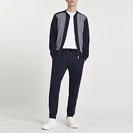 Navy dogtooth panelled bomber jacket