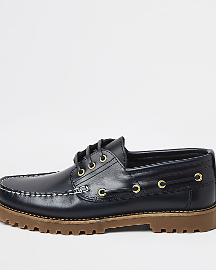 Navy leather cleated sole boat shoes