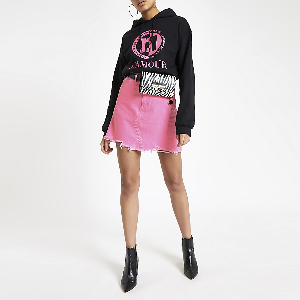 Neon pink mini denim skirt