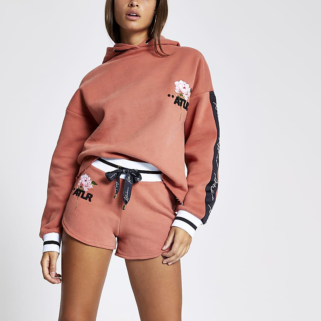 Orange ATLR floral printed runner shorts