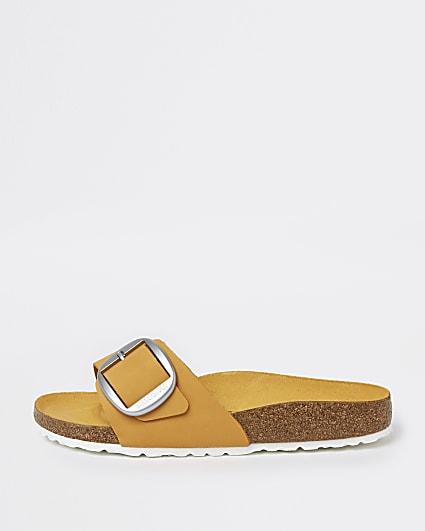 Orange Birkenstock buckle sandals