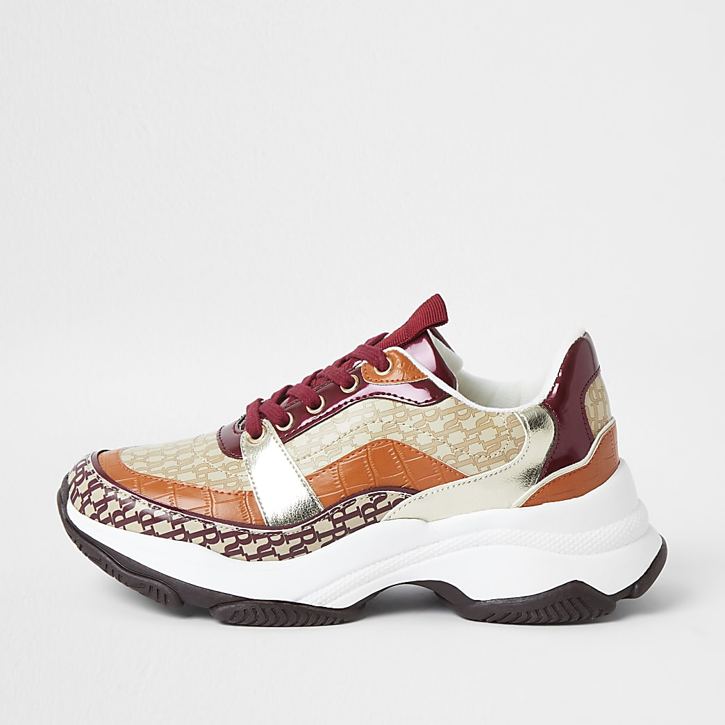 Orange chunky RI monogram print trainers