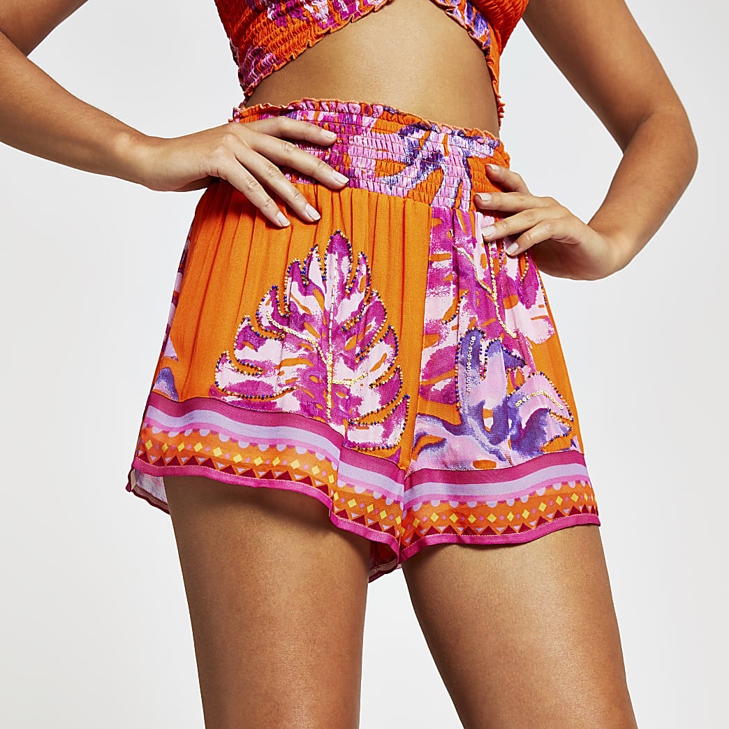 Orange floral beach shorts