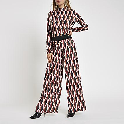 Orange geo print wide leg trousers