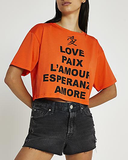 Orange graphic print cropped t-shirt