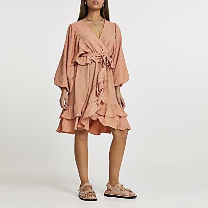 Orange long sleeve frill wrap dress