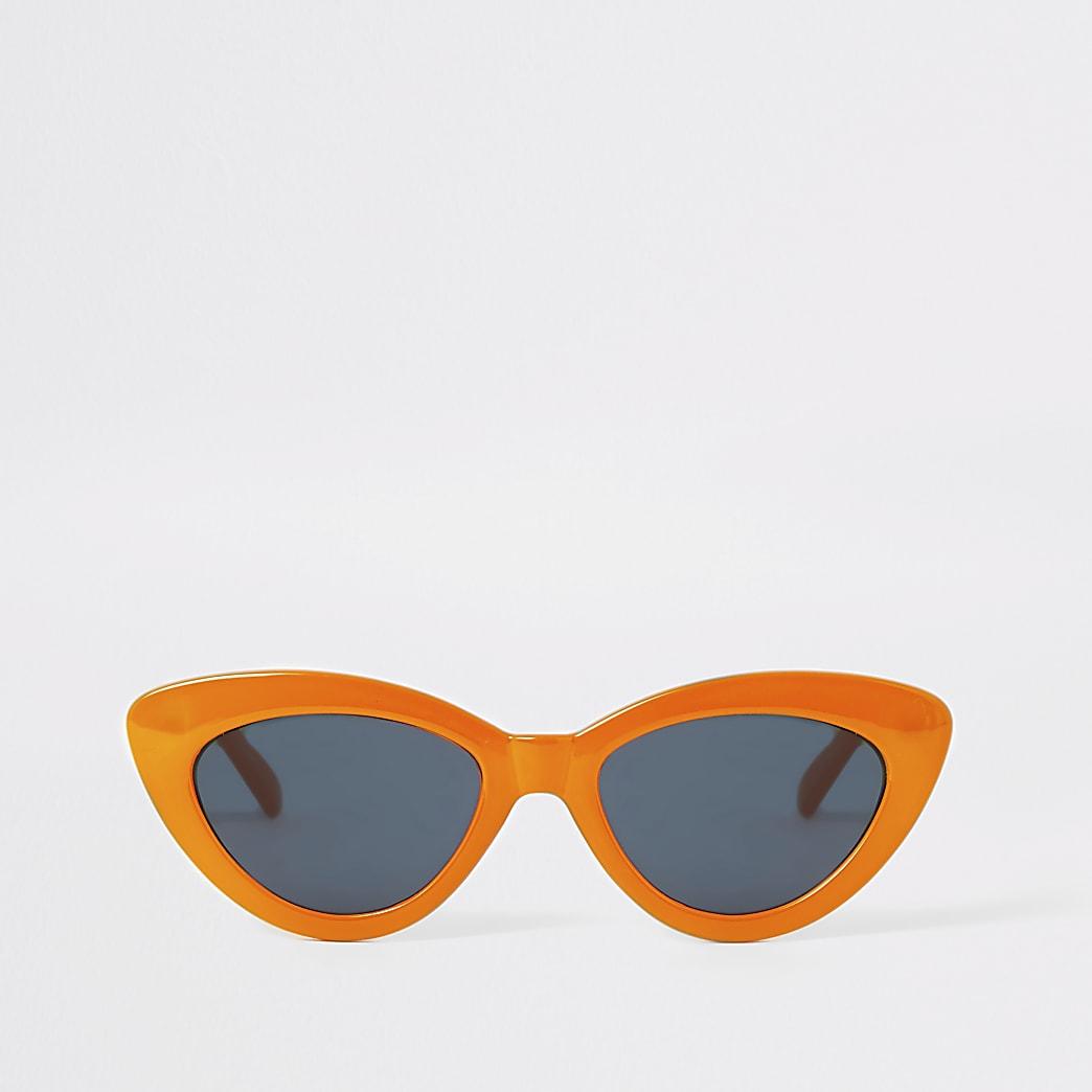 Oranje smalle zonnebril met kattenoogmontuur