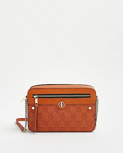 Orange RI monogram embossed cross body bag