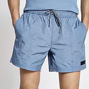 Pastel Tech – Blaue Badeshorts mit Kordelzug