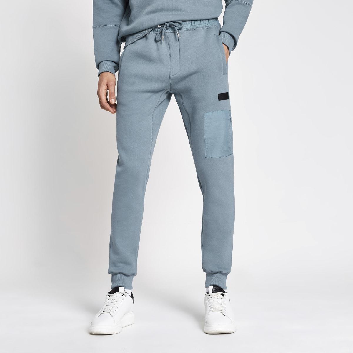 Pastel Tech - Blauwe nylon joggingbroek met kleurvlakken