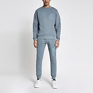 Pastel Tech – Blaues Sweatshirt mit Nylon-Brusttasche
