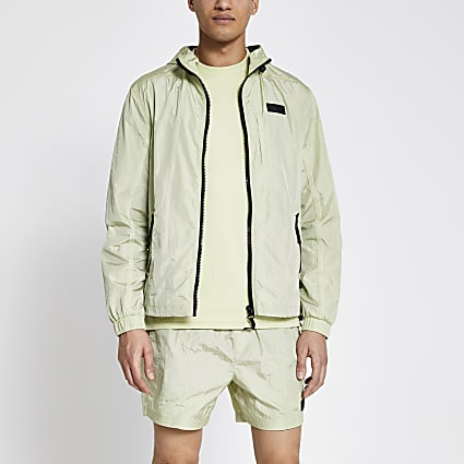 Pastel Tech green nylon hooded jacket