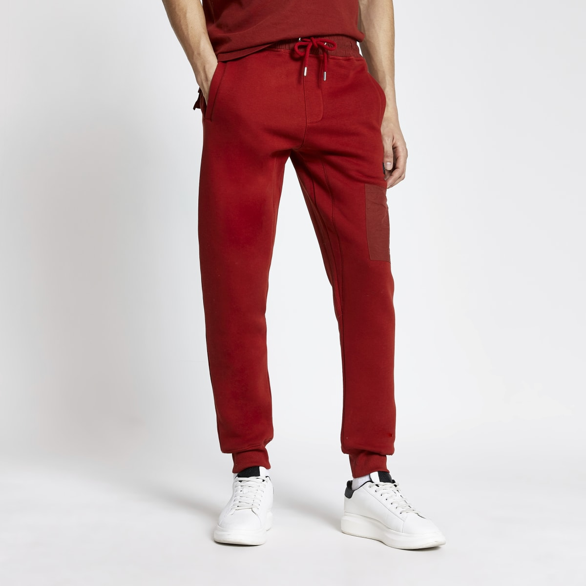 Pastel Tech red nylon blocked joggers